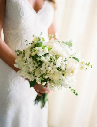 brides-bouquet-of-white-flowers-with-greenery