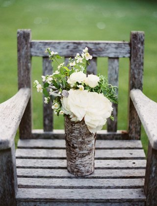 wedding-arrangement-of-white-flowers-in-a-vase-wrapped-with-birch-wood