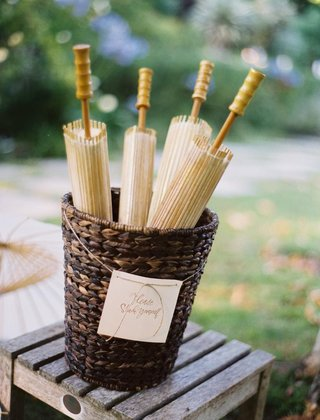 parasols-in-a-wicker-basket-for-an-outdoor-wedding