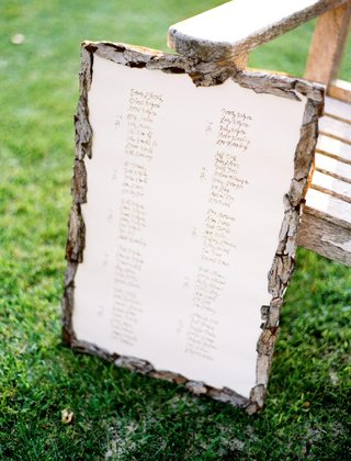outdoor-wedding-reception-with-a-seating-chart