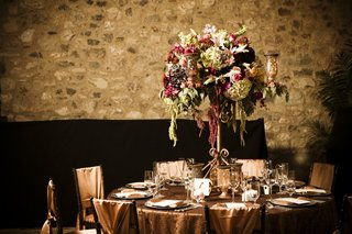 copper-reception-table-and-chairs-with-bohemian-floral-arrangement