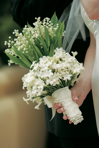 stephanotis-and-lily-of-the-valley-wrapped-in-ribbon