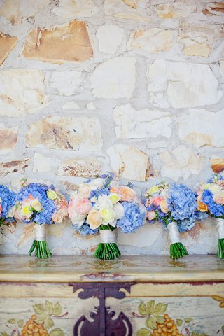 large-bride-bouquet-and-smaller-bridesmaid-nosegays