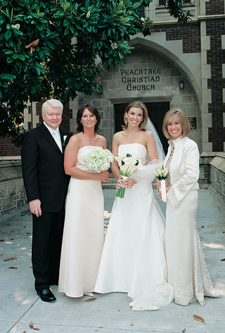 woman-in-strapless-wedding-dress-outside-church