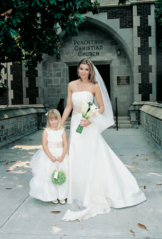woman-in-wedding-dress-with-young-girl
