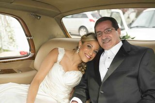 father-of-the-bride-inside-champagne-tan-limo