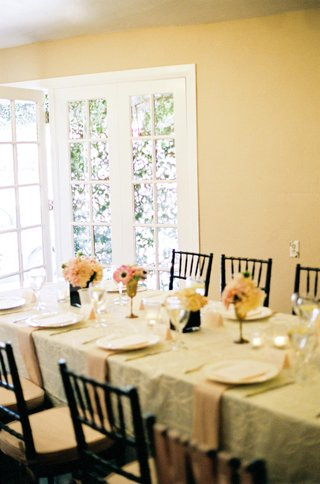 black-chairs-and-rectangular-table-with-ivory-linens
