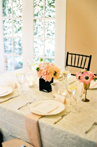 tablescape-with-ivory-linens-and-peach-accents