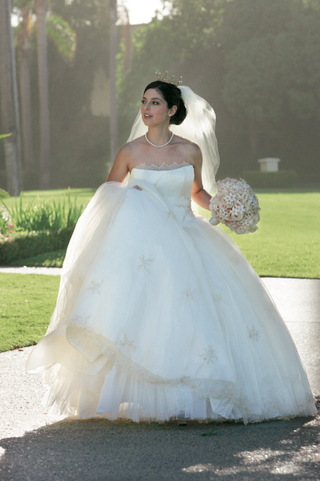 bride-in-white-ball-gown-with-pearl-necklace-and-crown
