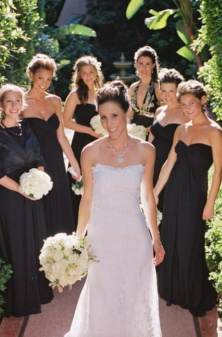 bride-with-bridesmaids-in-black-dresses-outside