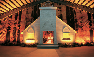 a-chapel-fascade-in-front-of-fall-forest-backdrop