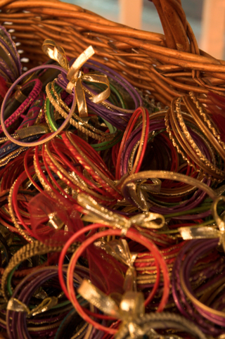 india-bracelets-tied-with-gold-ribbons