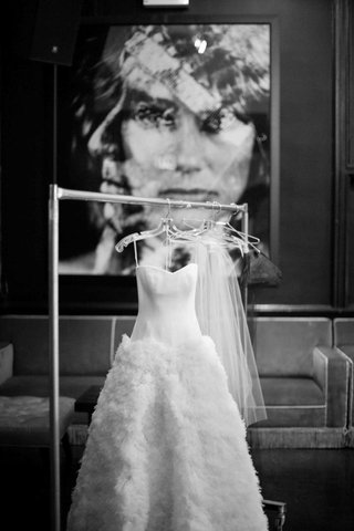 black-and-white-photo-of-wedding-dress-on-rolling-rack