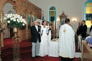 bride-and-groom-in-greek-orthodox-church-ceremony