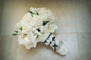 all-white-flowers-wrapped-in-lace-and-rosary