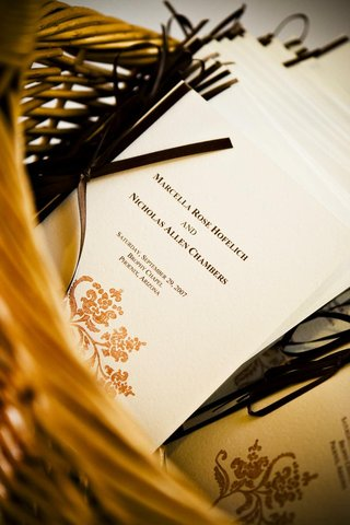 wedding-programs-stamped-with-gold-design-in-basket