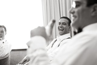 black-and-white-photo-of-groom-laughing
