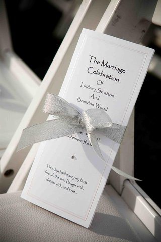 silver-ribbon-around-rectangular-ceremony-booklet