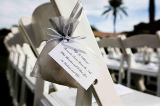 silver-organza-bag-tied-to-ceremony-chairs