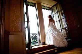 bride-shows-the-back-of-her-pnina-tornai-ball-gown