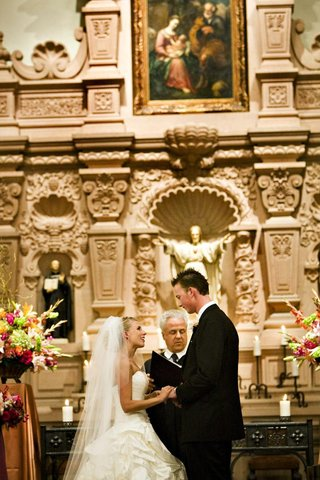 bride-and-groom-at-chapel-altar-with-catholic-priest