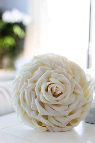 wedding-bouquet-with-rose-petals-glued-together-to-look-like-one-flower