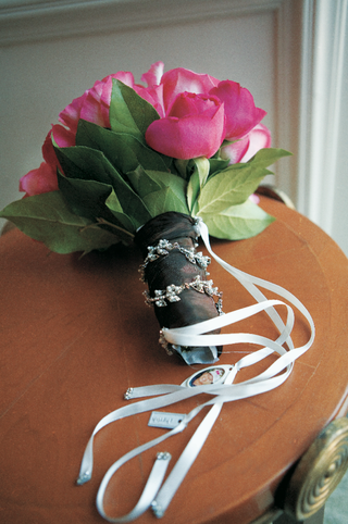 bouquet-of-pink-flowers-wrapped-in-brown-fabric