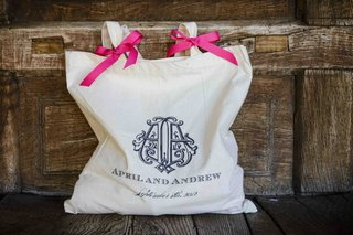 wedding-welcome-bag-with-pink-ribbons-and-monogram