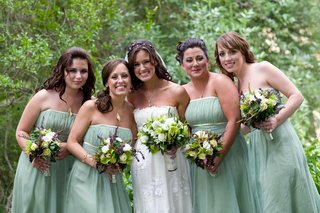 bride-in-claire-pettibone-gown-with-bridesmaids-in-light-green-dresses