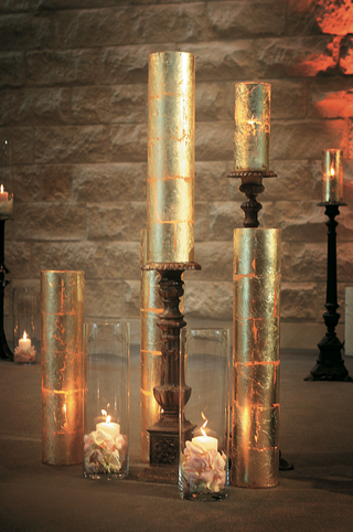 pillar-candles-in-glass-vase-with-flowers