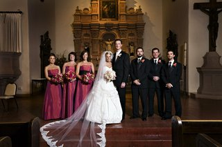 bride-and-groom-at-church-altar-with-bridesmaids-and-groomsmen