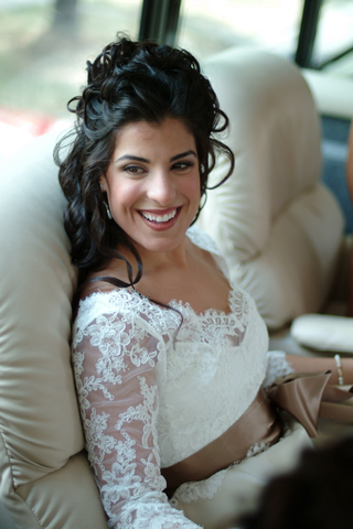 bride-getting-ready-with-curly-brown-hair-and-pretty-makeup