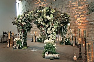 gold-candles-surrounding-floral-embellished-chuppah