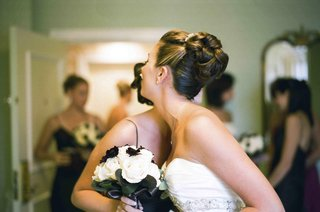 bride-wearing-knotted-bun-updo