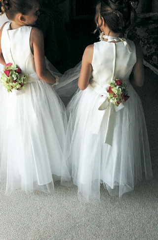 white-flowing-gowns-tied-with-ribbon-and-flowers