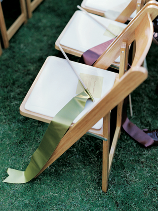 green-and-brown-ribbons-on-wedding-ceremony-chairs