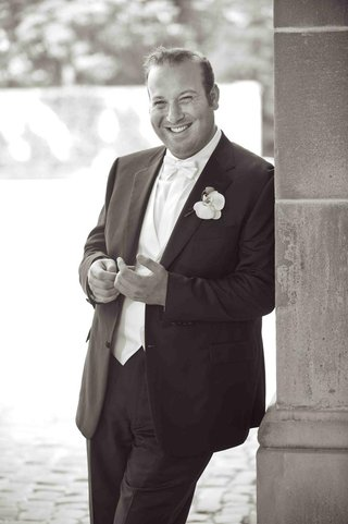black-and-white-photo-of-groom-in-a-brioni-tuxedo-and-orchid-boutonniere