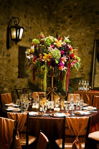 candelabra-flower-centerpiece-on-copper-reception-table
