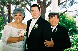 groom-with-mother-of-groom-and-father-at-outdoor-wedding