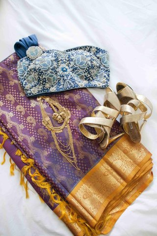 brides-purple-and-gold-wedding-ceremony-sari-and-the-beaded-blue-top-of-her-reception-outfit