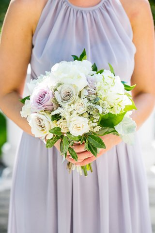 bridesmaid-in-lavender-bridesmaid-dress-holding-bouquet-of-white-peony-white-rose-purple-rose