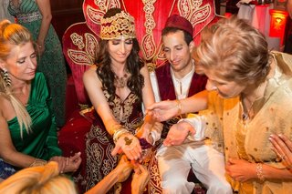 bride-and-groom-with-henna-on-palm-of-hands
