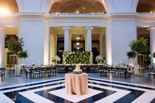 wedding-reception-navy-and-white-diamond-motif-dance-floor-chicago-museum-cake-in-center-reception