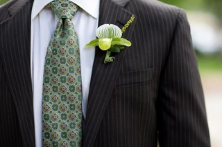 groom-in-a-pinstripe-suit-light-green-tie-and-lady-slipper-boutonniere