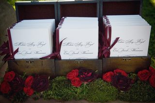 wood-box-holding-burgundy-and-white-booklets