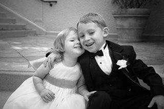 black-and-white-photo-of-young-flower-girl-and-ring-bearer-hugging