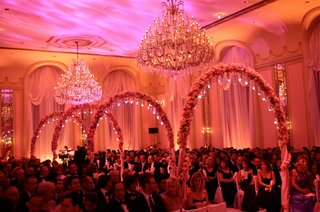 ballroom-wedding-ceremony-with-chandeliers-and-pink-lighting