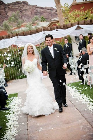 mlb-player-brandon-wood-exiting-ceremony-with-wife