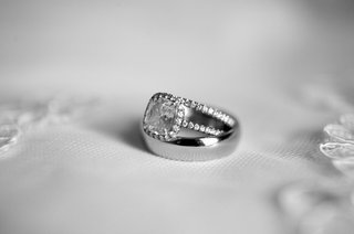 black-and-white-photo-of-engagement-ring-and-wedding-rings