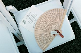 wedding-ceremony-chair-topped-with-fan-and-program